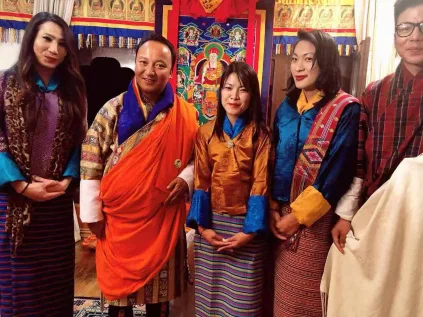 Photo of bhutan's Minister of Finance with members of the LGBT+ community